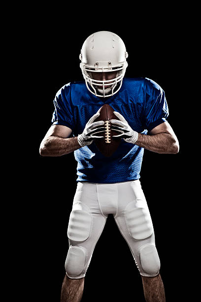 football player with a ball 03 - american football player stock photos and pictures