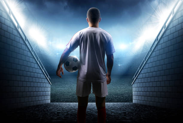 football player with ball in the stadium - soccer player stock photos and pictures