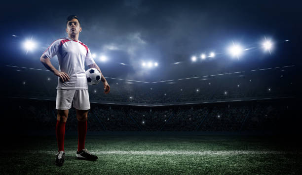 football player with ball on field of stadium - soccer player stock photos and pictures