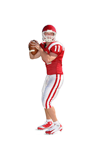 Football Player with Clipping Path Quarterback dropping back to pass. Isolated on white with drop shadow and clipping path. quarterback stock pictures, royalty-free photos & images