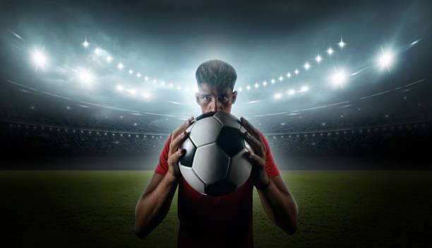 Football player with stadium lights stock photo