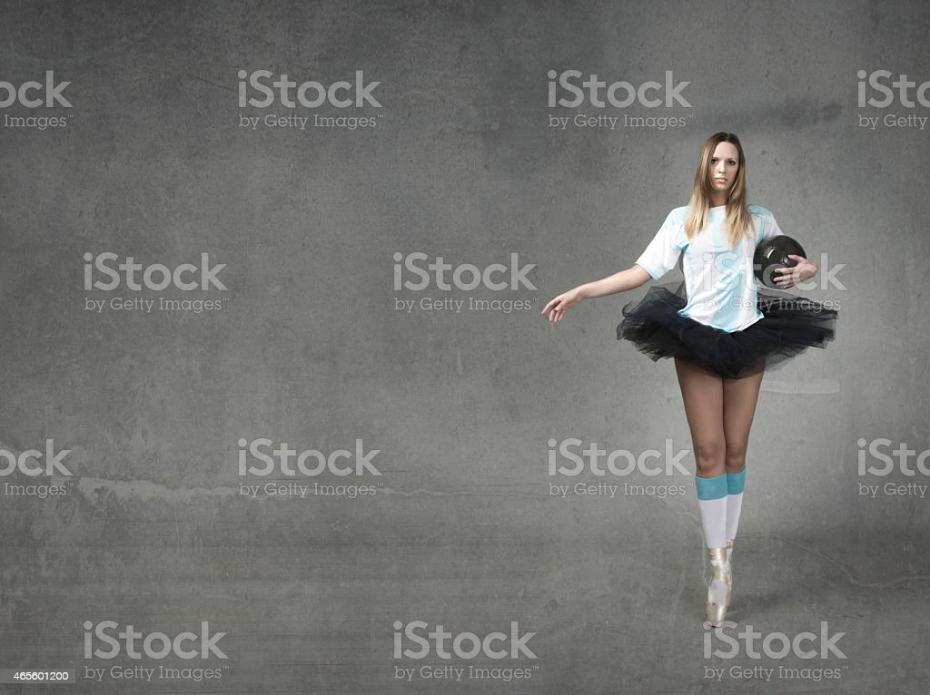 football player with tutu on point stock photo