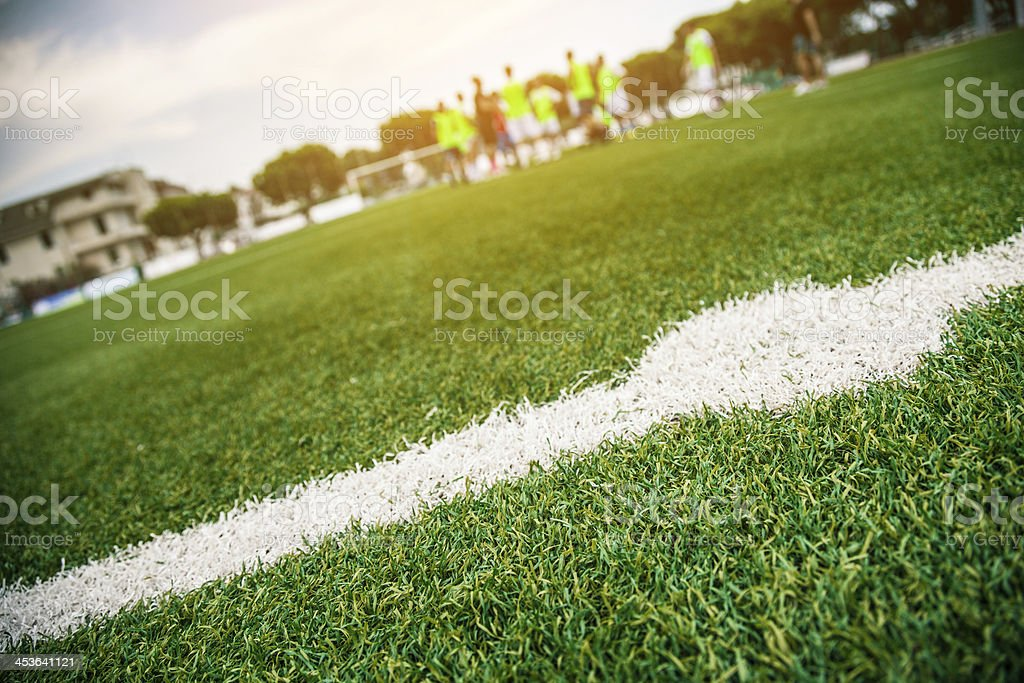 Football players athletic training in summer stock photo