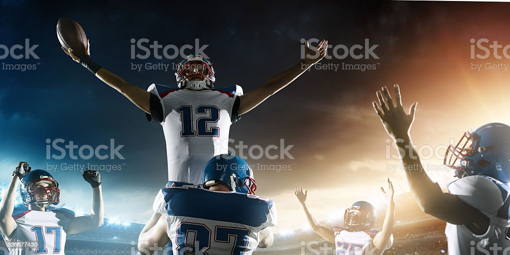 Football Players celebrate their victory stock photo