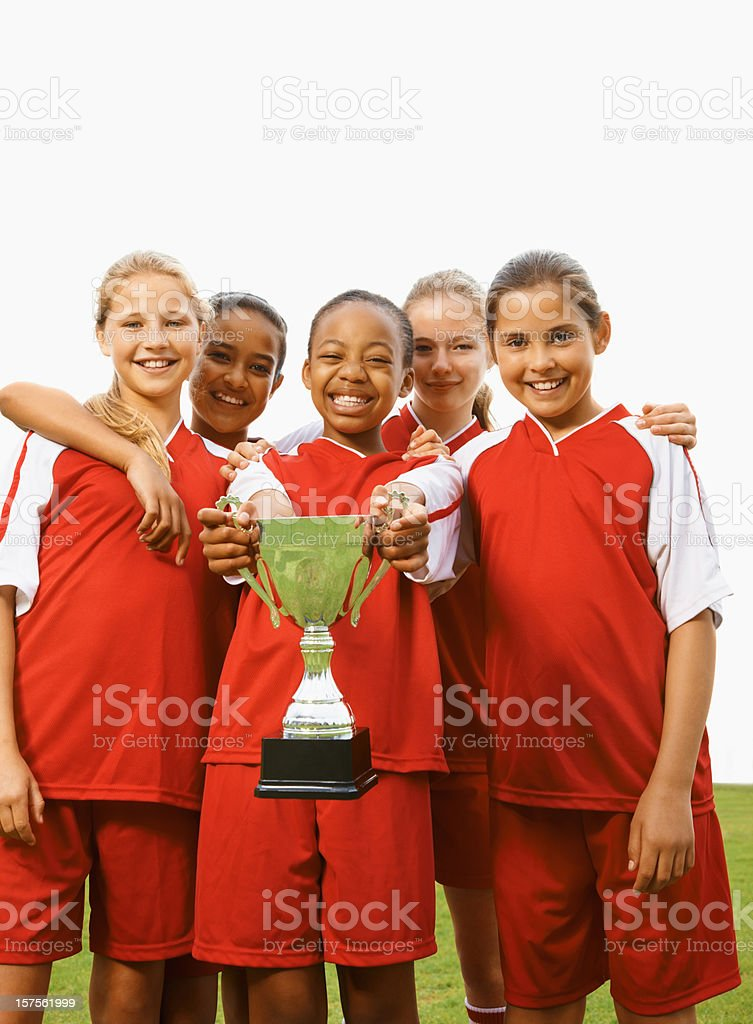 Football players celebrate victory with trophy royalty-free stock photo