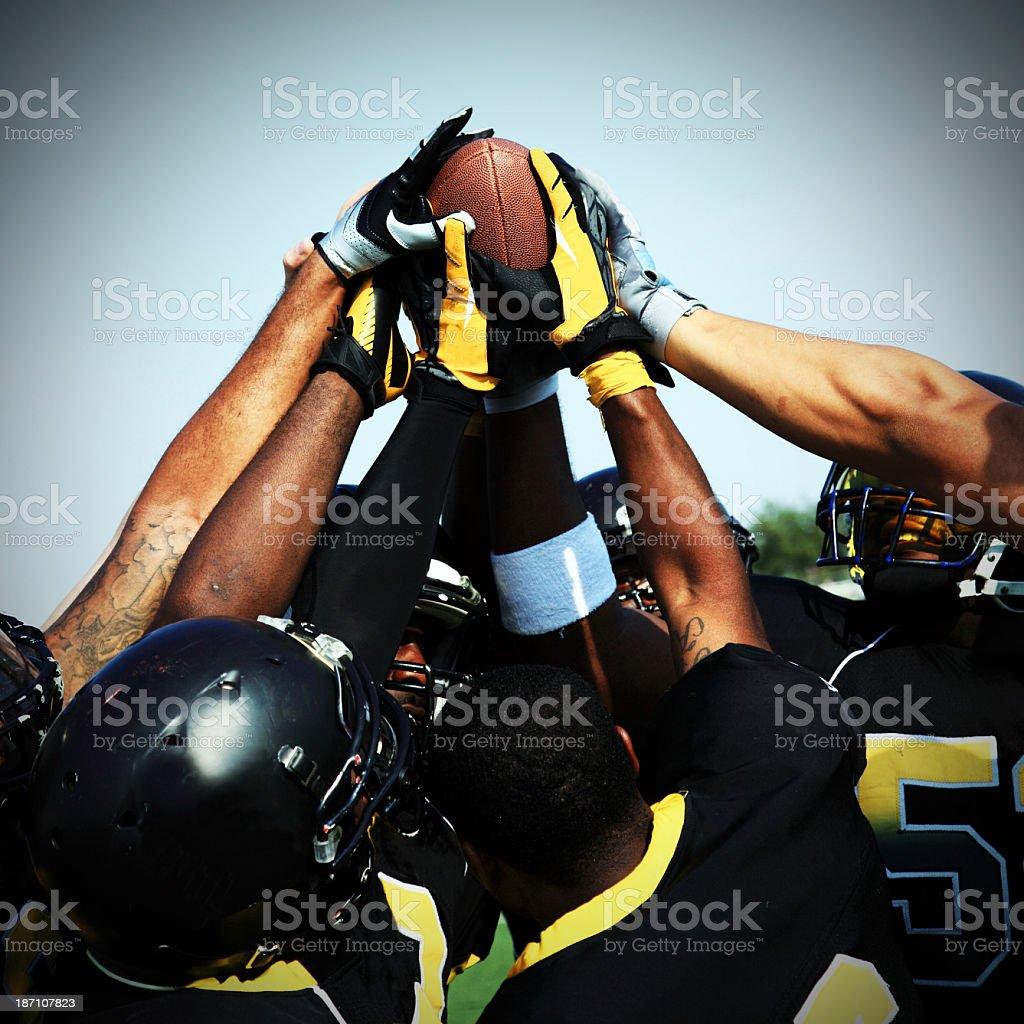 Football players celebrating touchdown stock photo