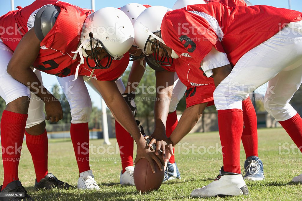 Football Players in Huddle stock photo