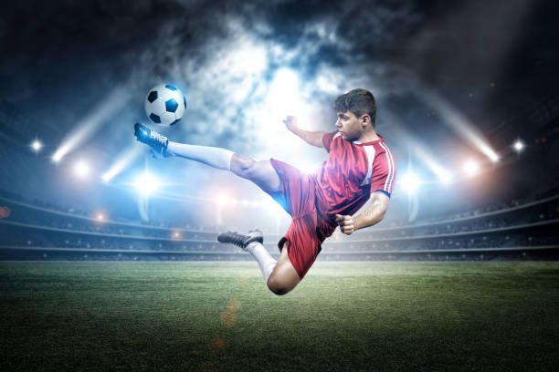 football player's kicking in the stadium - sports championship stock photos and pictures