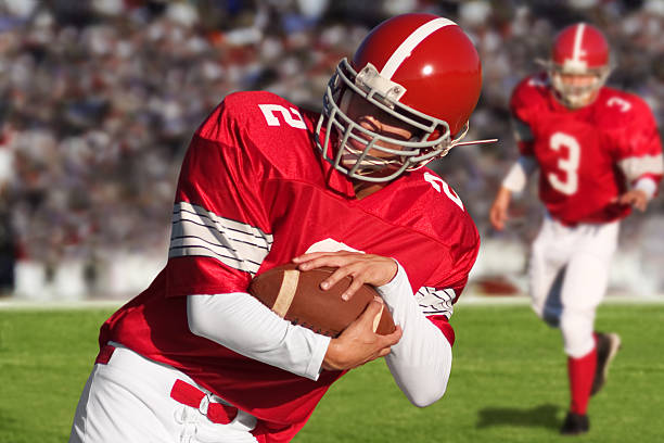 Football Players on Field Two football players on the field.   quarterback stock pictures, royalty-free photos & images