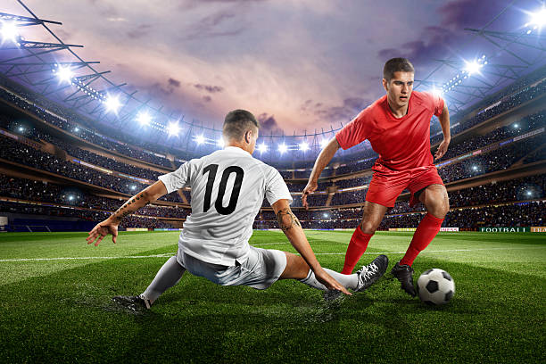 football players - soccer player stock photos and pictures