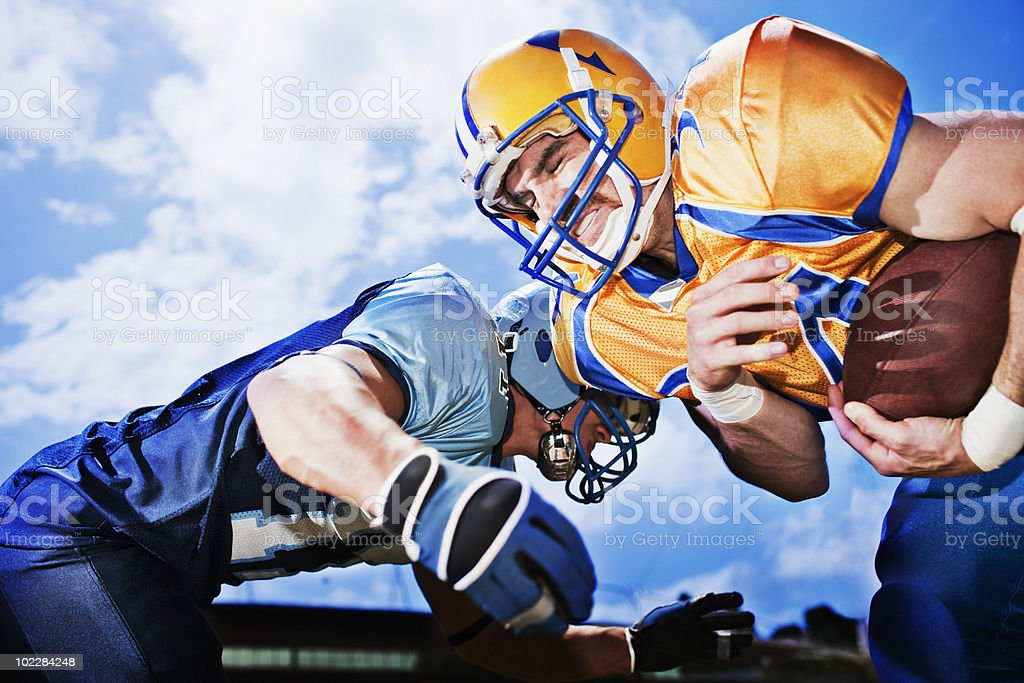 Football players playing football stock photo