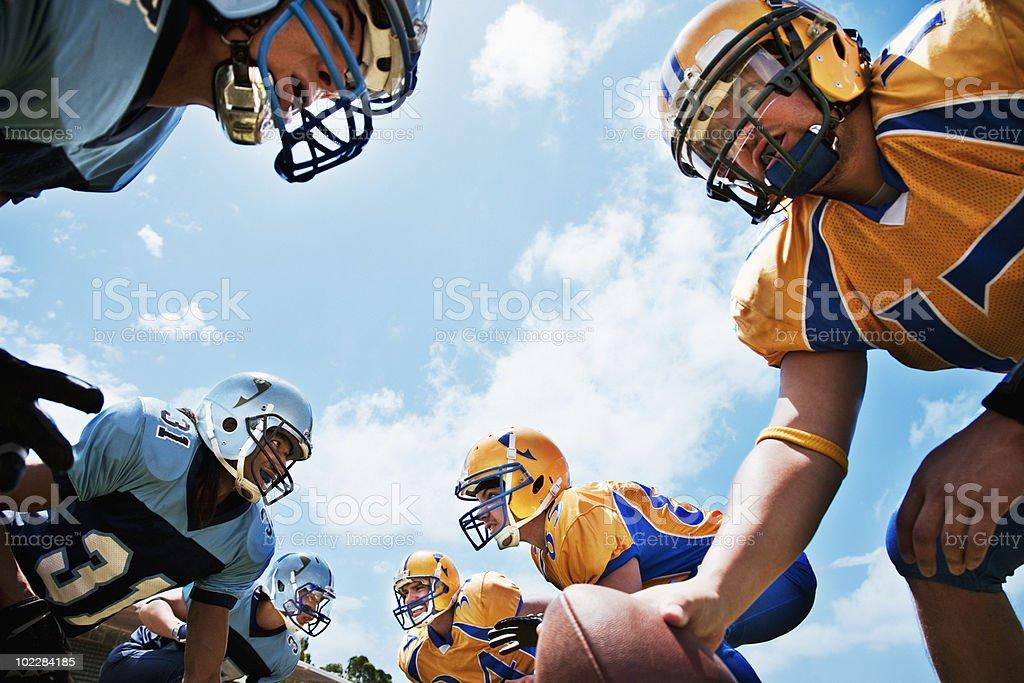 Football players preparing to play football stock photo