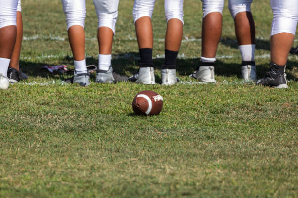 football players ready for the game - high school sports stock pictures, royalty-free photos & images