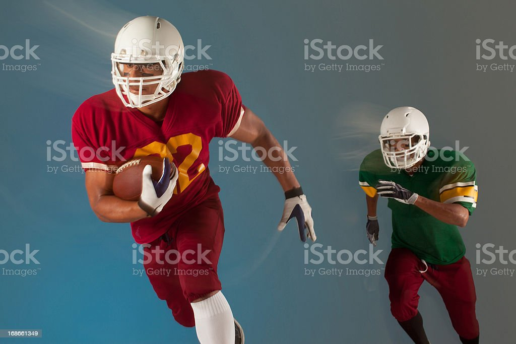Football players running with ball royalty-free stock photo