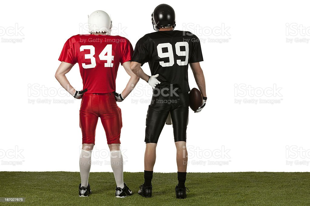 Football players standing with arms akimbo stock photo