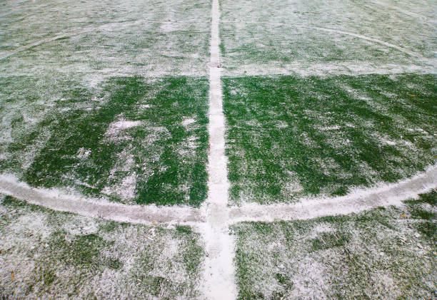 Football playground after the snowstorm background stock photo