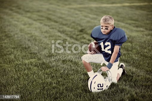 Portrait of a young American boy ready to take the football field.