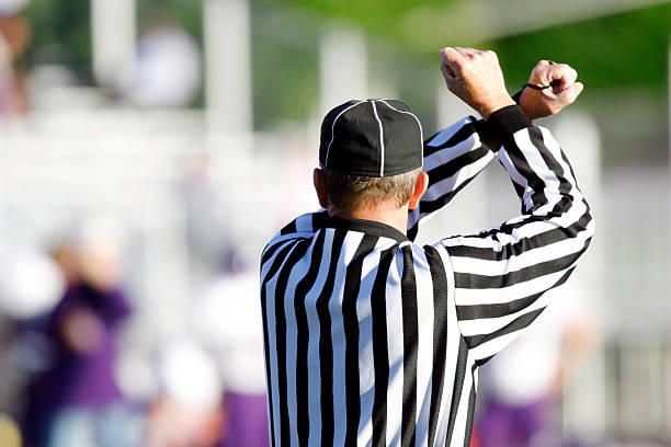 Football Referee A football referee making a call. referee stock pictures, royalty-free photos & images