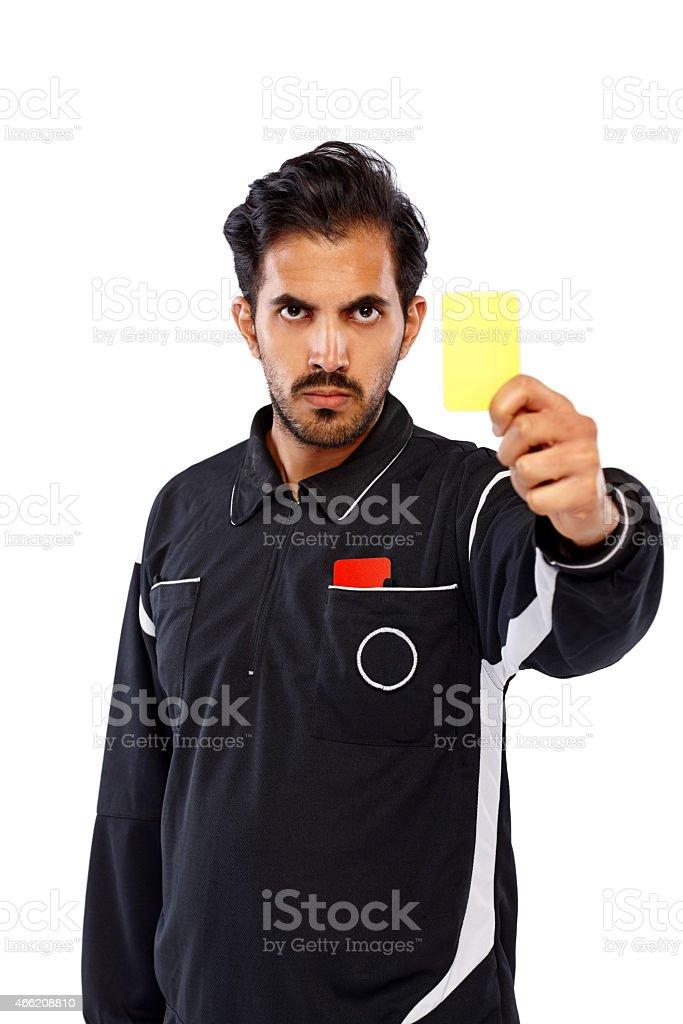 Football referee showing yellow card stock photo