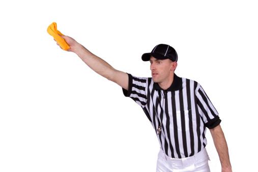 Football referee throwing flag