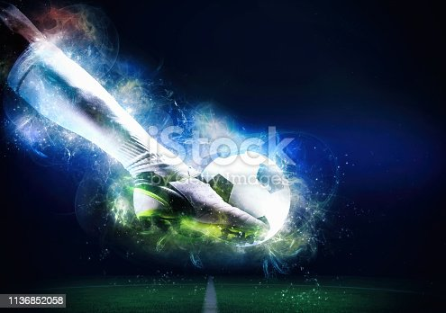 istock Football scene at night match with player ready to shoot the ball 1136852058
