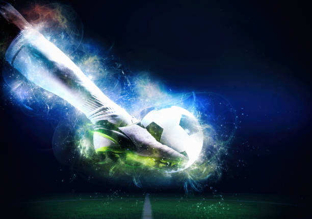 Football scene at night match with player ready to shoot the ball - foto stock
