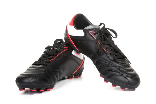 A pair of football shoes on white background