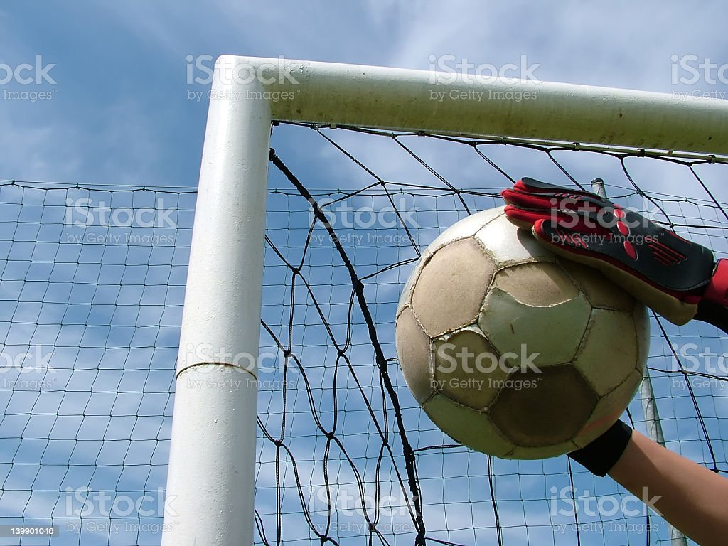 Football - soccer ball in goal royalty-free stock photo