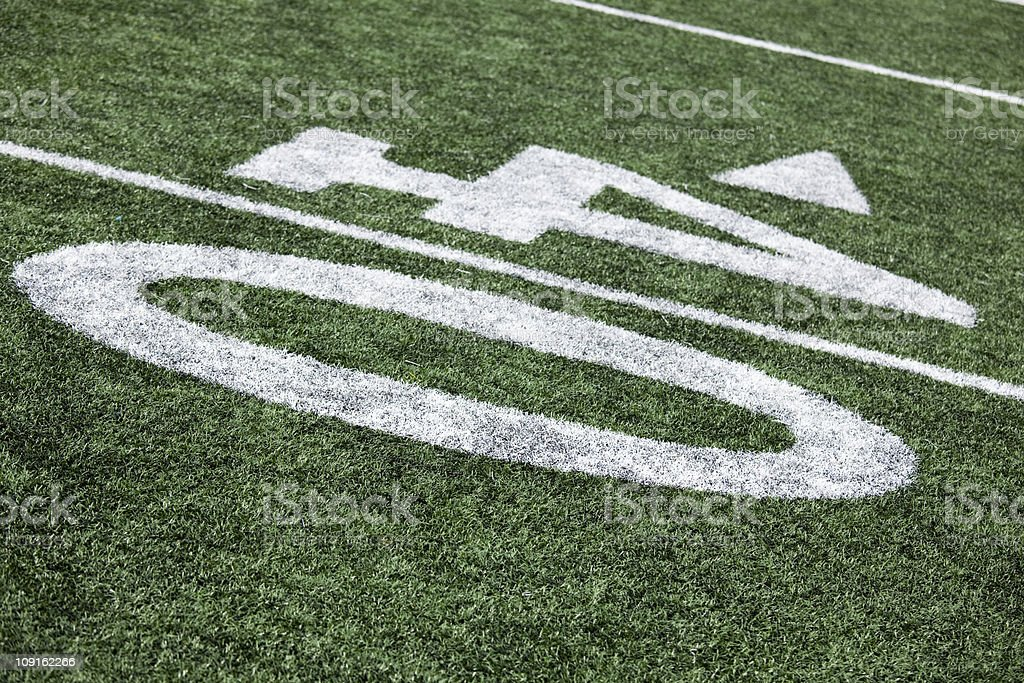 Football stadium 40 yard line artificial grass and markings royalty-free stock photo