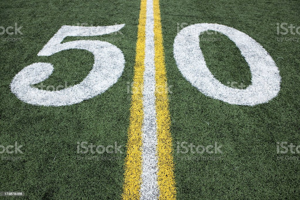 Football stadium 50 yard line artificial grass and markings royalty-free stock photo