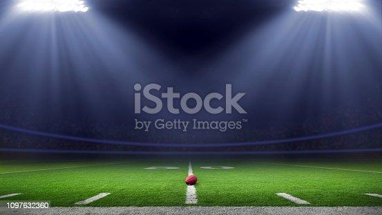 American football field illuminated by stadium lights