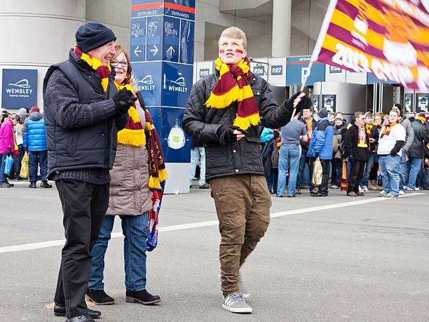 Football supporter waving flag stock photo