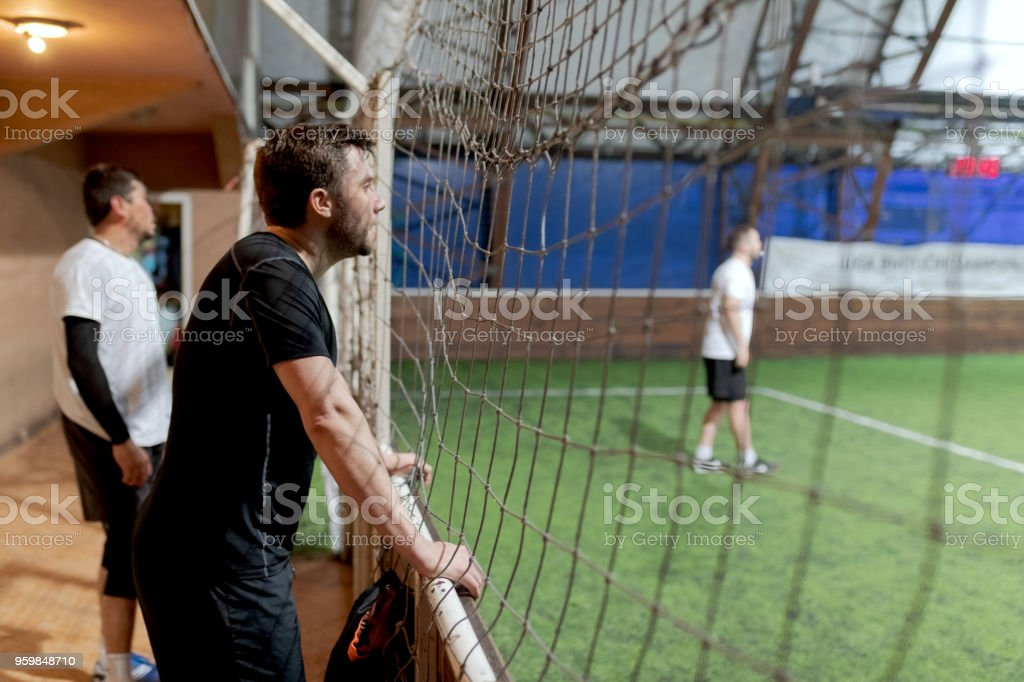 Football supporters watching game stock photo