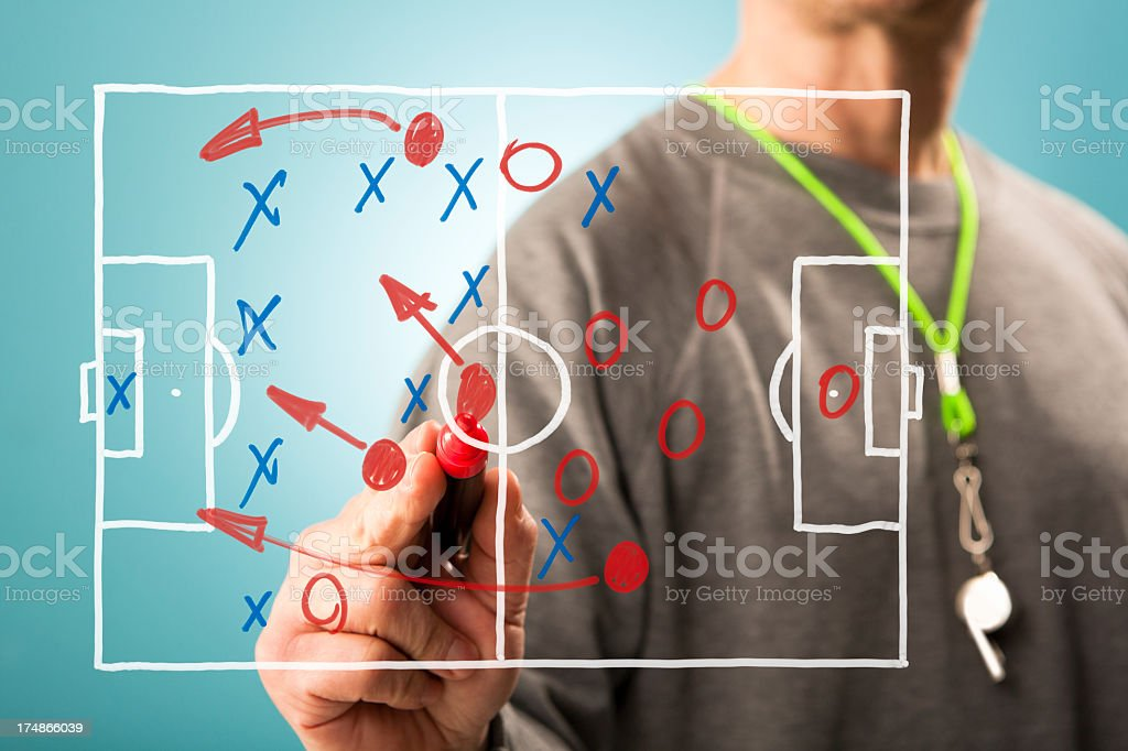 Football tactics Football coach writing tactics down on a screen. Shallow depth of field, focus on the pen tip. Advice Stock Photo