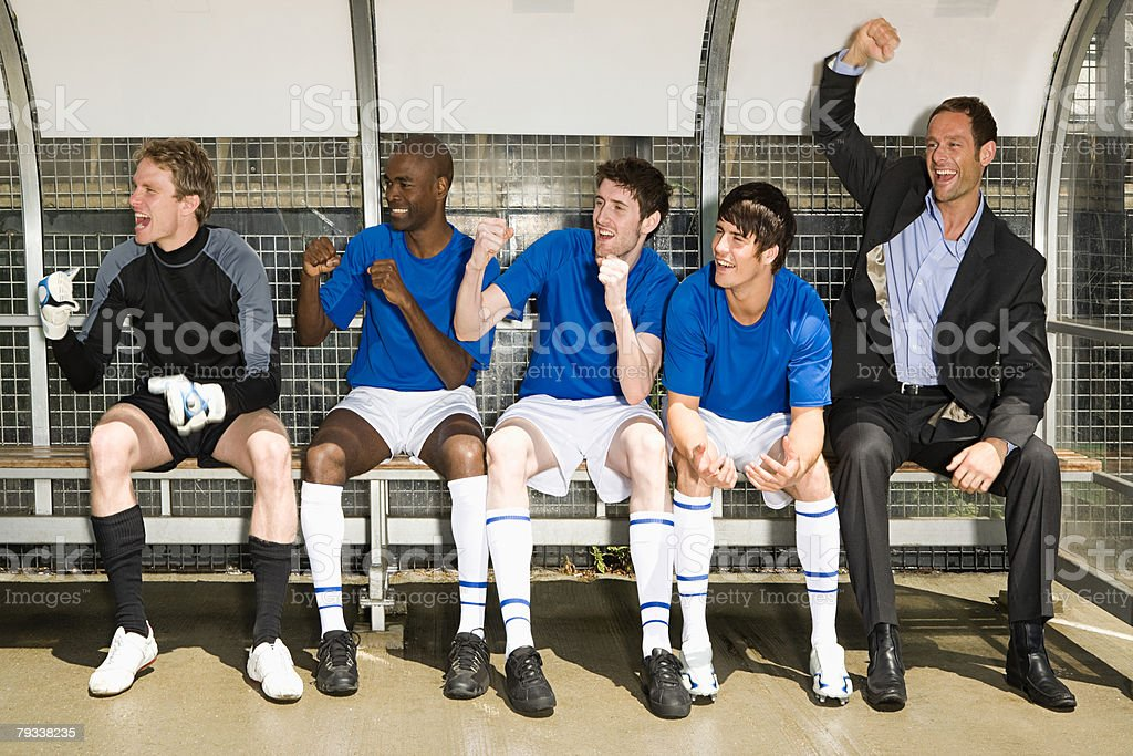 A football team and football manager celebrating 免版稅 stock photo