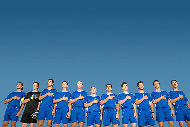 football team in a row - national anthem stock photos and pictures