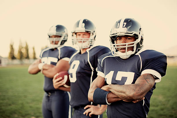 Football Team A trio of American football teammates are ready to put up some points. wide receiver athlete stock pictures, royalty-free photos & images