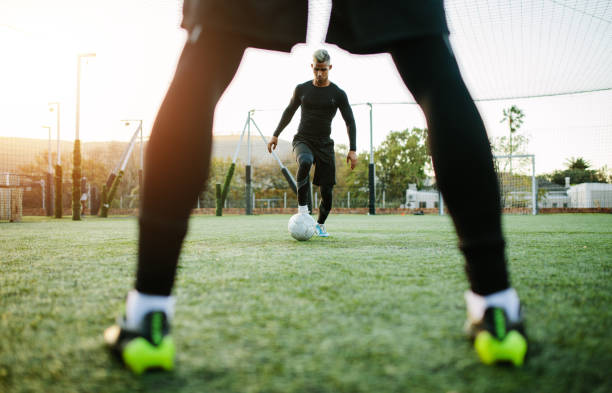 Football team practicing on soccer pitch stock photo