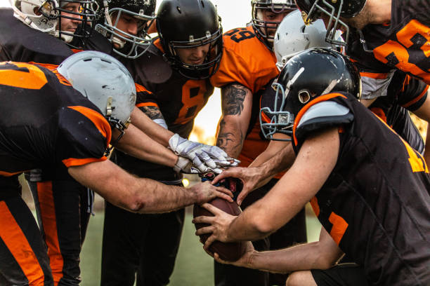 Football Team starting match American Football Players Starting Match At Stadium, high angle view training equipment stock pictures, royalty-free photos & images