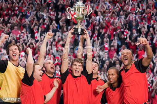istock Football team winning a trophy 105777417