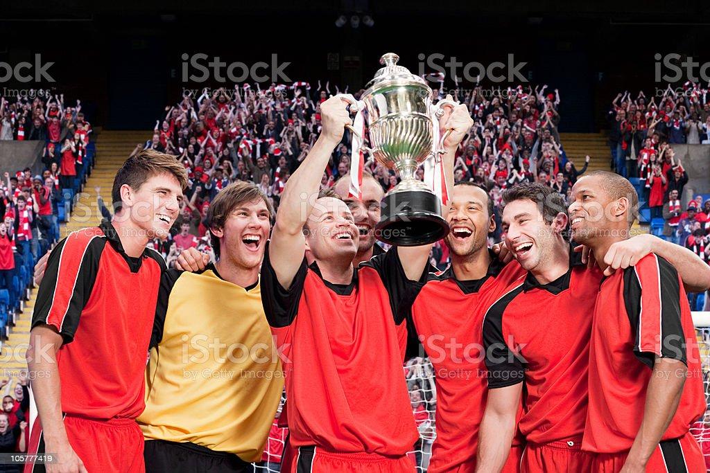 Football team winning a trophy stock photo