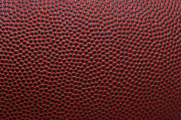 Football texture Detailed macro of american football football lineman stock pictures, royalty-free photos & images
