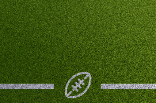 Football theme paint on empty grass field