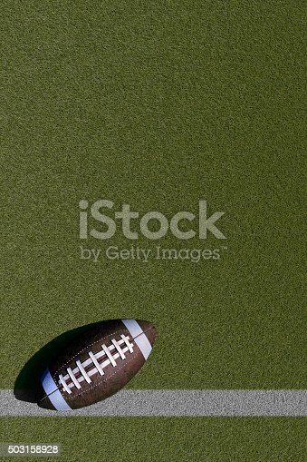 Football theme on empty grass field