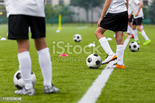 istock Football Training Practice Exercises for Youth Soccer Players. Boys on Training with Soccer Balls on Pitch 1137528248