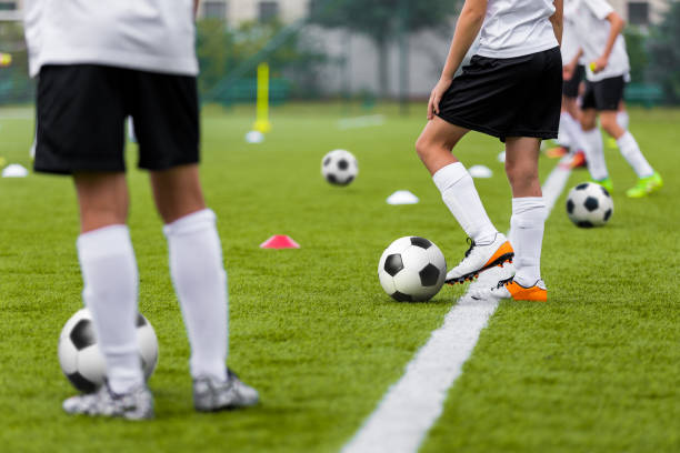 Football Training Practice Exercises for Youth Soccer Players. Boys on Training with Soccer Balls on Pitch Football Training Practice Exercises for Youth Soccer Players. Boys on Training with Soccer Balls on Pitch leisure equipment stock pictures, royalty-free photos & images