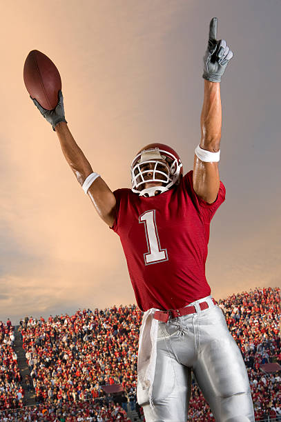 football victory - american football player stock photos and pictures