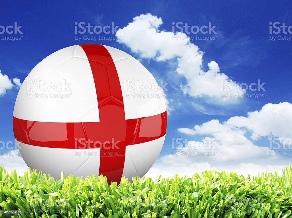 Football with flag of England on green grass stock photo