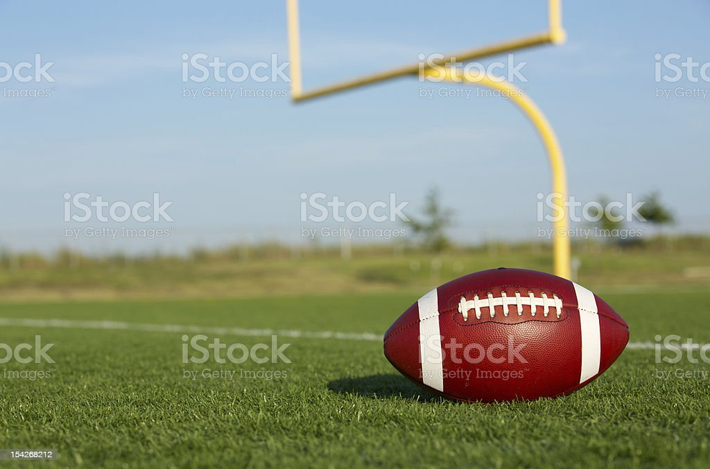 Football with Goal Posts Beyond stock photo