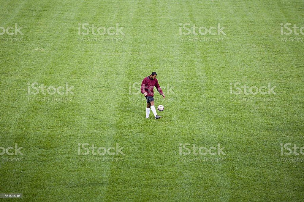 Footballer alone on field royalty-free stock photo